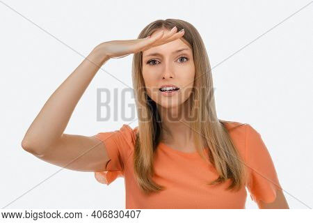 Portrait Of A Curious Blond Girl In Casual Clothes Looking Far Away With Hand At Her Forehead, Tryin