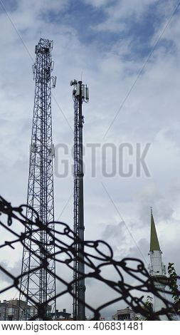 Mosque Minarets And Cellular Network Towers With Fence. Freedom Of Speech Concept.