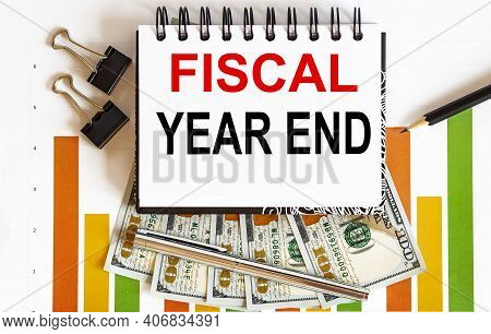 Notebook With Tools And Notes About Fiscal Year End ,business Concept