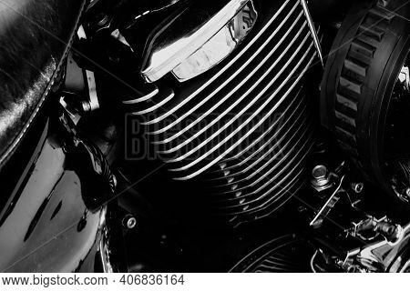 Powerful Motorcycle Engine Block With Chrome Details And Reflective Surfaces, Black And White Close-