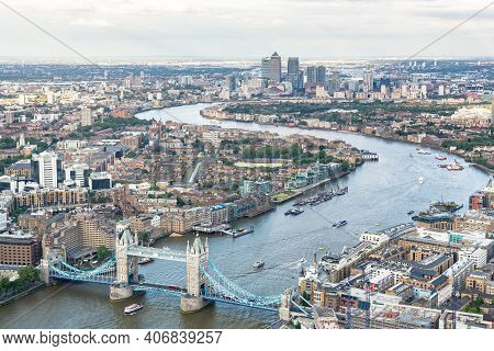 London, Uk - July 03, 2013. London Tower Bridge And Canary Wharf (docklands). Aerial View Of The Riv