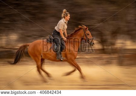 Slow Pan Of Blonde Riding Past Trees