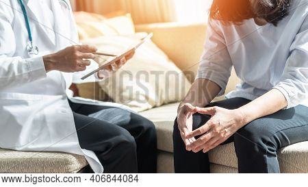 Menopause Woman, Stressful Patient Consulting With Doctor Or Psychiatrist Who Diagnostic Examining O