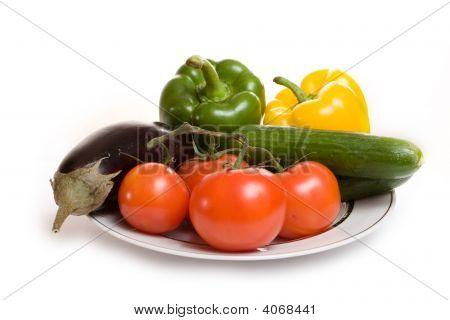 Aubergine Tomato Cucumber Sweet Pepper On Plate