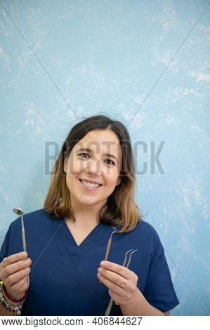 Cheerful And Beautiful Dentist Holding Instrumentation And Smiling In Dental Clinic.copy Space.women