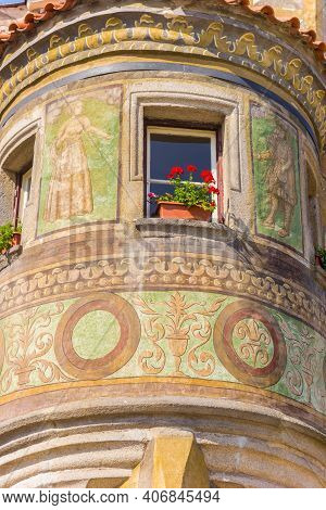 Window With Flowers On A Decorated Facade In Telc, Czech Republic