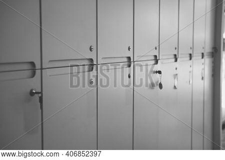 White School Lockers And Key In Locker Room