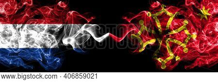 Netherlands Vs Occitania Smoky Mystic Flags Placed Side By Side. Thick Colored Silky Abstract Smoke