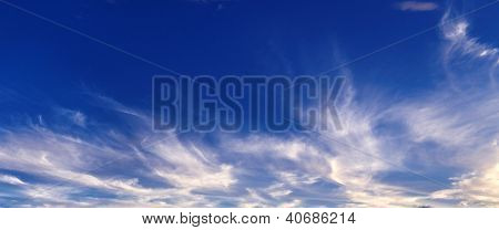Wispy White Cloud Against A Vivid Blue Sky.