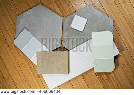 Flooring Remnants And Color Swatches Against Hardwood Floor Background