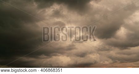 Dark Storm Cloud Rain Clouds In Sunset Or Sunrise Sky Dramatic Black Cloudscape In Bad Weather Day.