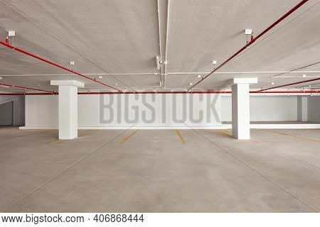 Empty Parking Garage Underground Interior In Apartment Or Business Building Office And Superstore.