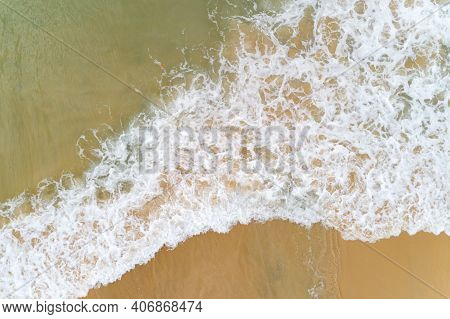 Aerial Top View Tropical Beach Sea Wave Splashing On Sandy Shore White Sea Foam.