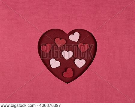 Cutted Paper Heart On Pink Background. Paper Art On Valentine Day. Paper Cut And Craft Style. Space
