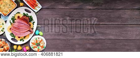 Classic Easter Ham Dinner. Overhead View Border On A Dark Wood Banner Background With Copy Space. Ha