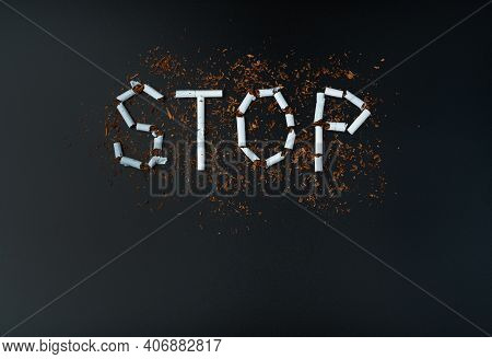 Anti-smoking, The Word Stop Is Laid Out Of White Cigarettes On A Black Background.