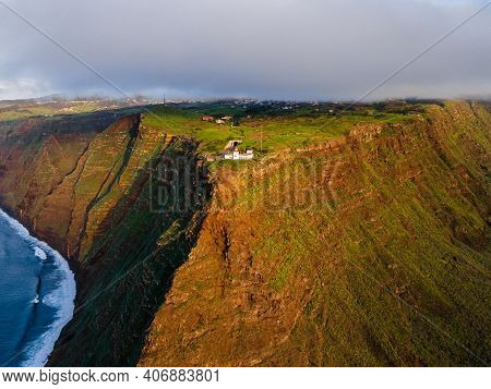 The Cliff Lighthouse Ponta Do Pargo On The Cliff Coast Of The Island Of Madeira - Wonderful Cloudy C