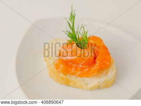 Sandwich Or Canape & Salmon On White Plate Background Cutout. Canape With Smoked Salmon On Dish With