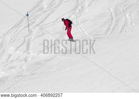 Snowboarder In Red Downhill On Snowy Off-piste Slope After Snowfall At Cold Winter Day
