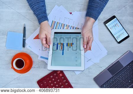 Businessman Hands Using Tablet Computer With Stock Market Data. Money And Trade Concept.