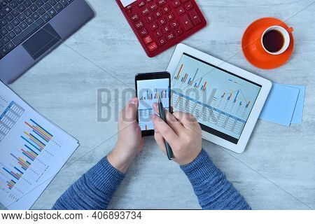 Businessman Using Mobile Phone And Checking Stock Market Data. Success And Startup Concept. Close Up