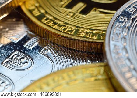 Golden And Silver Coins With Bitcoin Symbol. Cryptocurrency And Payment Concept. Close Up