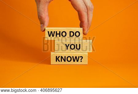 Who Do You Know Symbol. Businessman Hand. Wooden Blocks With Words 'who Do You Know'. Beautiful Oran