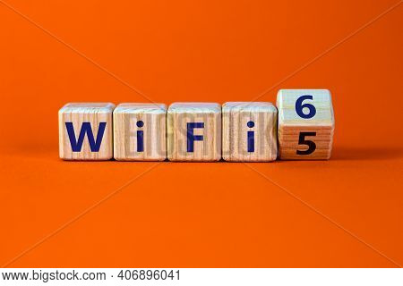 Wifi 5 Or 6 Symbol. Turned A Wooden Cube And Changed The Words Wifi 5 To Wifi 6. Beautiful Orange Ba