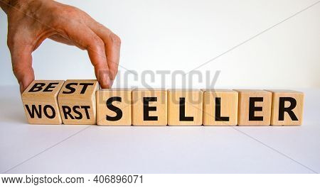 Worst Or Best Seller Symbol. Businessman Flips Wooden Cubes And Changes Words 'worth Seller' To 'bes
