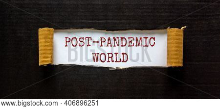Post-pandemic World Symbol. The Words 'post-pandemic World' Appearing Behind Torn Black Paper. Beaut