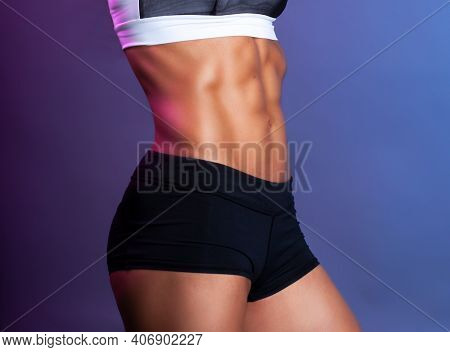 perfect muscular female abdominal muscles abs isolated studio close up shot