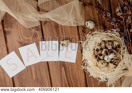 Easter Sale Message With Easter Eggs On A Wooden Background. Top View.