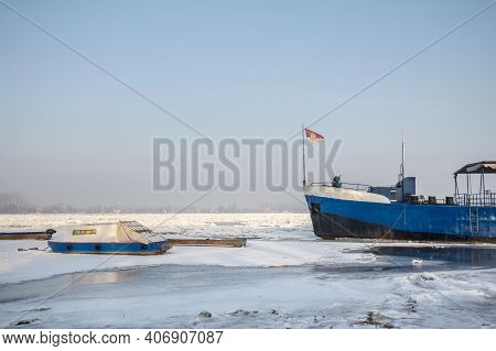 Cargo Ship And A Boat Trapped On Frozen Danube During The 2017 Winter, In Zemun, Belgrade, Serbia Wi