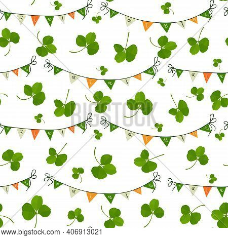 Festive Pattern With Flags And Shamrock Leaves In The Colors Of The Irish Flag On A Seamless Backgro