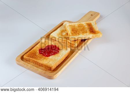 Toast Isolated On White Background. Toast On Wooden Board.