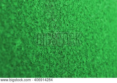 Vivid Green Background Or Wallpaper. Rough Rugged Matt Surface. The Backdrop Is Bright And Rich In C