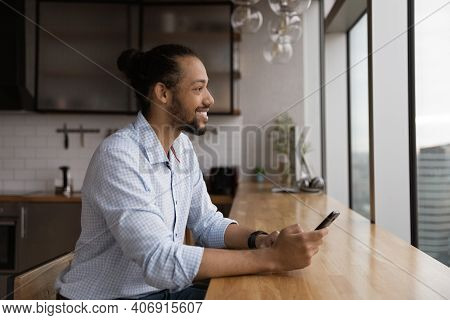Positive Black Male Renter Of Apartment Dream Distracted From Cell