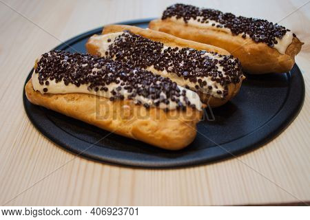 Traditional French Eclairs With Chocolate. Tasty Dessert. Home Made Cake Eclairs. Sweet Dessert Past