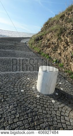 White Concrete Pillar In Newly Repaired Street In Andalusian Village Winter Sunshine