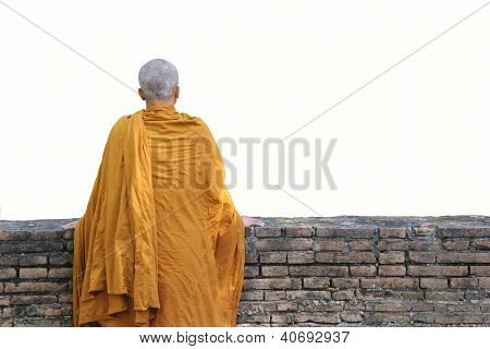 Monk Stand In Front Of The Old Wall