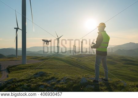 Technician Engineer In Wind Turbine Power Generator Station Launches A Drone For Visual Control Of G