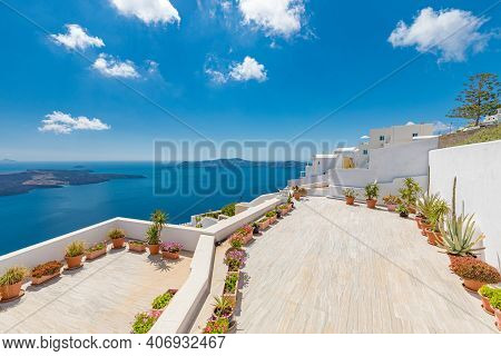 White Wash Staircases On Santorini Island, Greece. The View Toward Caldera Sea With Flowers. Terrace