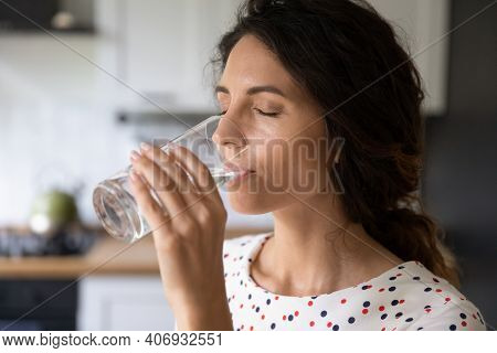 Thirsty Young Woman Drink Water From Glass