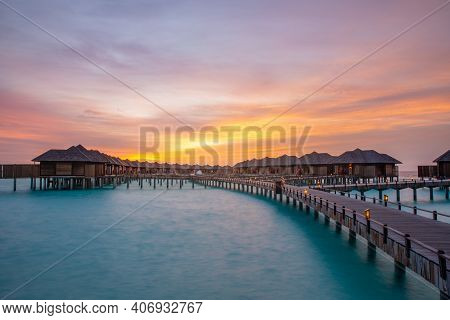 Sunset In Maldives Island. Beautiful Sunset Sky And Clouds, Luxury Water Villas And Wooden Pathway P