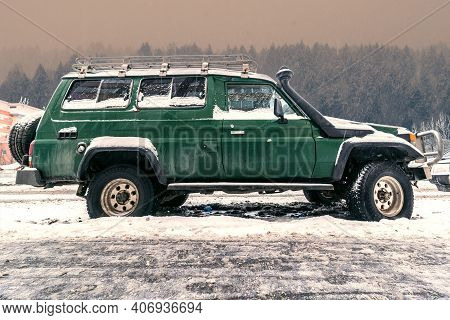 Old 4x4 Car On The Background Of Snowy Woods Landscape. Travel And Trip On Auto In North Region. Aut