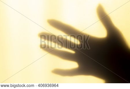 A Blurred Shadow Of A Hand On A Painted Wall, The Shadow Of A Woman's Hand