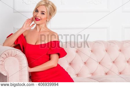 Sensual And Romantic Beautiful Blonde Woman Posing In Red Stylish Dress  Nice Lady With Bright Hair