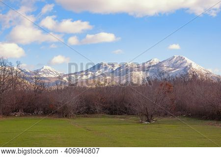 Winter Mountain Landscape, Snow-capped Mountains And Green Grassland. Bosnia And Herzegovina, Republ