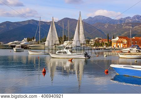 Winter Mediterranean Landscape With Sailboats And Fishing Boats On Water. Montenegro, View Of Kotor