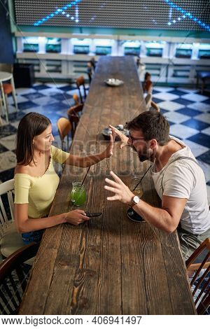 Modern couple having a fight in a cafe